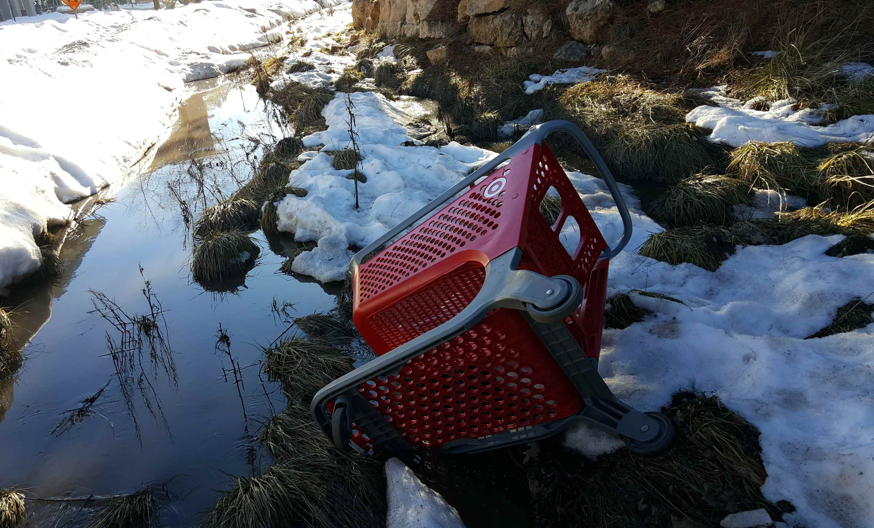 Image - Target Shopping Cart in Snowy Stream - Ped. Bridge near The Suites - Feb. 2017